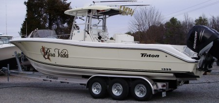 35 TRITON CC ON A HI-TECH MARINE TRAILER