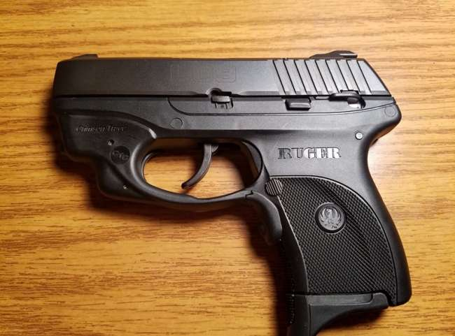 Ruger LC9 9MM w/ Crimson Trace Laser and extended magazine