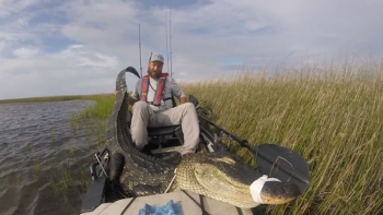 Daniel Wilson, of Mobile, Alabama, poses with the 9-foot gator he shot Sept. 1, during Mississippi's alligator season. After a 40-minute fight with a Penn 6000 Series rod and reel, Wilson was able to dispatch the gator with a shot from his 20-gauge.