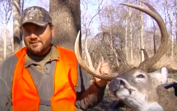 Greg Hackney poses with a nice buck he shot during the rut along the Mississippi River.